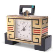 A GILT-BRASS AND ENAMEL ALARM CLOCK, IN THE ART DECO TASTE