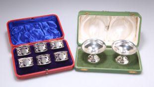 A SET OF SIX EDWARDIAN SILVER NAPKIN RINGS