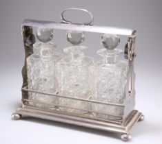 A LATE VICTORIAN SILVER-PLATED THREE-BOTTLE TANTALUS
