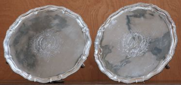 A LARGE PAIR OF GEORGE III SILVER SALVERS