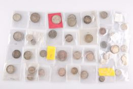A COLLECTION OF MOSTLY SILVER FOREIGN COINS