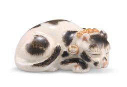 A JAPANESE MEIJI PERIOD KUTANI PORCELAIN MODEL OF A SLEEPING CAT