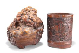 A CHINESE ROOT WOOD CARVING AND A BAMBOO BRUSH POT