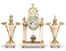 A LATE 19TH CENTURY FRENCH GILT-BRASS AND ONYX CLOCK GARNITURE