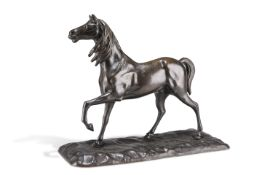 A PATINATED BRONZE MODEL OF A HORSE
