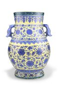 A CHINESE BLUE AND WHITE YELLOW-GROUND TWO-HANDLED VASE, HU