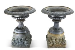 A LARGE AND IMPRESSIVE PAIR OF CAST IRON URNS