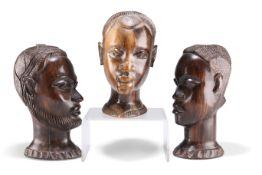 THREE AFRICAN HEAD CARVINGS