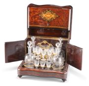 A 19TH CENTURY FRENCH INLAID AMBOYNA SERPENTINE DRINKS CABINET