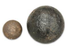 TWO ANTIQUE IRON CANNON BALLS