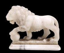 A 19TH CENTURY ALABASTER CARVING OF A MEDICI LION