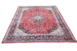 A FINELY WOVEN PERSIAN MASHAD CARPET