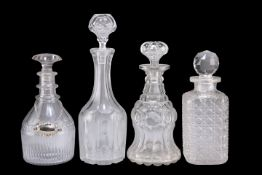 A GROUP OF FOUR GEORGIAN AND LATER GLASS DECANTERS