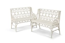 """A PAIR OF WHITE PAINTED METAL """"GOTHIC"""" GARDEN BENCHES"""