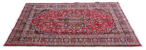AN IRANIAN HAND-KNOTTED WOOL CARPET, MASHAD