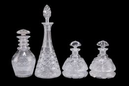 A SMALL STUART CRYSTAL CUT GLASS DECANTER AND THREE OTHER DECANTERS