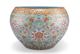 A CHINESE TURQUOISE GROUND PORCELAIN JARDINIÈRE