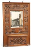 GIGGLESWICK SCHOOL, AN ARTS AND CRAFTS CARVED OAK HALL MIRROR CIRCA 1905