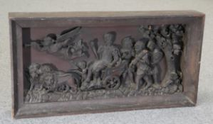 AN 18TH CENTURY CARVED OAK PANEL