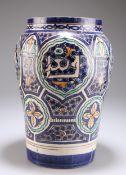 A LARGE PERSIAN TIN-GLAZED EARTHENWARE VASE
