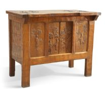 """AN UNUSUAL ARTS AND CRAFTS OAK """"HUNTING"""" CABINET"""