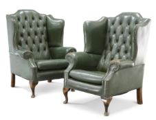 A PAIR OF GREEN LEATHER BUTTON-BACK WING-BACK ARMCHAIRS
