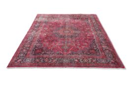 A LARGE PERSIAN MASHAD CARPET