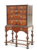 AN 18TH CENTURY WALNUT CHEST ON LATER STAND