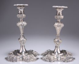 A PAIR OF BAROQUE REVIVAL SILVER-PLATED CANDLESTICKS