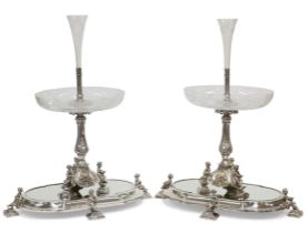 A HANDSOME PAIR OF 19TH CENTURY SILVER-PLATED CENTREPIECES ON MIRRORED STANDS