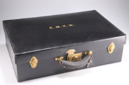 An Asprey ladies black leather travelling case with fitted tray of silver mounted bottles and