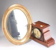 A faux rosewood cased mantel clock by Seth Thomas, USA with cream dial and Arabic numerals, 24cm