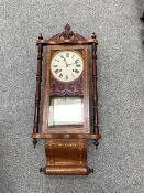 A late 19th Century inlaid walnut wall clock