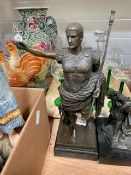 A 20th century patinated metal figure of Augustus Caesar, on a black marble base