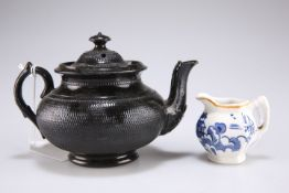 A black Jackfield type teapot and cover, 10cm high; and a small Continental blue and white porcelain