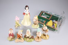 A group of limited edition Royal Doulton figures of Snow White andthe seven dwarfs, together with