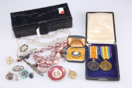 A small leather box with collection of paste and costume jewellery and a cameo brooch and two