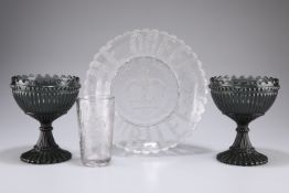 Two smoked glass chalices, together with a commemorative 1837-1887 Victorian pressed glass plate and