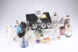 A quantity of glass perfume bottles, etc.