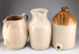 Three stoneware pitchers/flagons