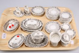 A late 19th Century English pottery child's tea service, transfer printed in brown, comprising