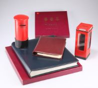 An Asprey's leather-bound loose-leaf address book, 18cm by 15cm boxed, a photograph album, boxed,