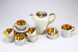 A Jersey pottery sage green and gold coffee set for six