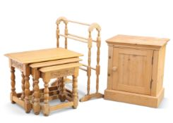 A nest of three oak tables; together with a pine single door bedside cupboard and a pine towel