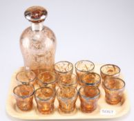 A silver and ochre coloured glass drinking set comprising decanter and 12 tumblers 6cm high