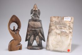 A figural carving, 20cm high, a carved stone figure of a native, 26cm and a rectangular carved