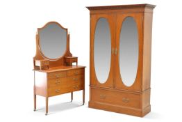 An Edwardian satinwood inlaid mahogany two-door wardrobe and dressing chest, the wardrobe with a