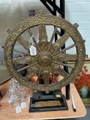A metal mounted dharma wheel