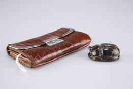 A silver mounted leather purse, 11.5cm and a carved scarab, 4cm(2)