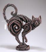 A modern resin sculpture of a cat, 40cm high overall